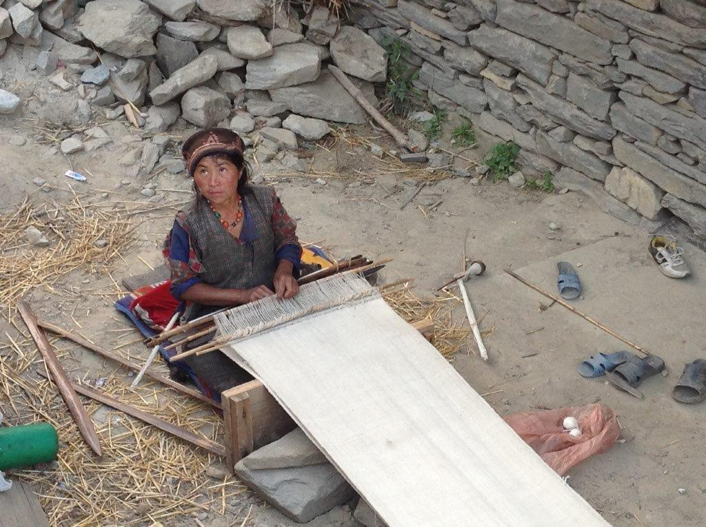 Gatlang Village woman weaving a traditional Tibetan shawl